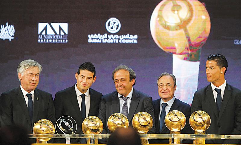Dubai: UEFA president Michel Platini (C) poses alongside (L to R) Real Madrid manager Carlo Ancelotti, midfielder James Rodriguez, president Florentino Perez and star attacker Cristiano Ronaldo at the Globe Soccer awards ceremony.—AFP