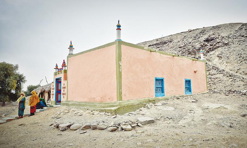 WOMEN standing on the steps of a Zikri praying area in Teertej, Awaran. —Fahim Siddiqi/White Star