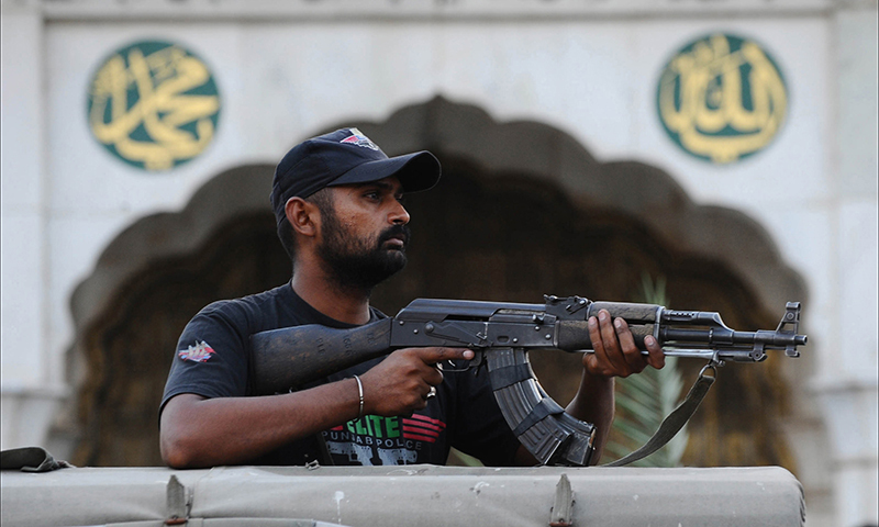 In this photo, a police commando stands guard in Lahore. — AFP/File