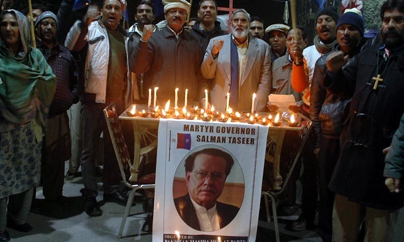 LAHORE: Activists of Pakistan Masiha Millat Party hold Candlelight Vigil to mark 4th death anniversary of slay Punjab Governor Salman Taseer outside Lahore Press Club. INP PHOTO by Hamid Moosa
