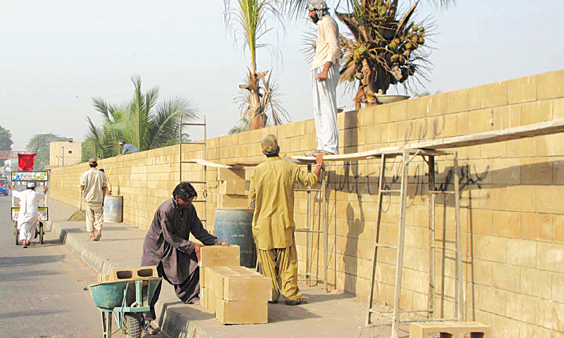The boundary wall of an army public school on Iqbal Shaheed Road in the Saddar area being reinforced on Thursday. —PPI