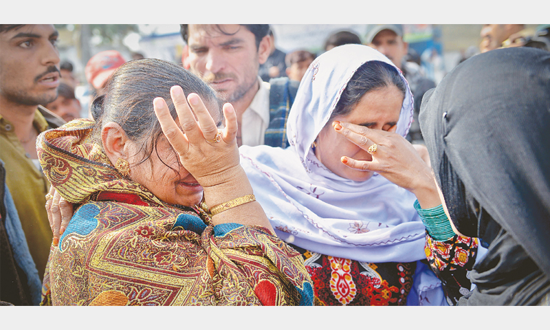 RELATIVES of the National Highway tragedy victims grieve at the Jinnah Postgraduate Medical Centre on Sunday.—Fahim Siddiqi/ White Star