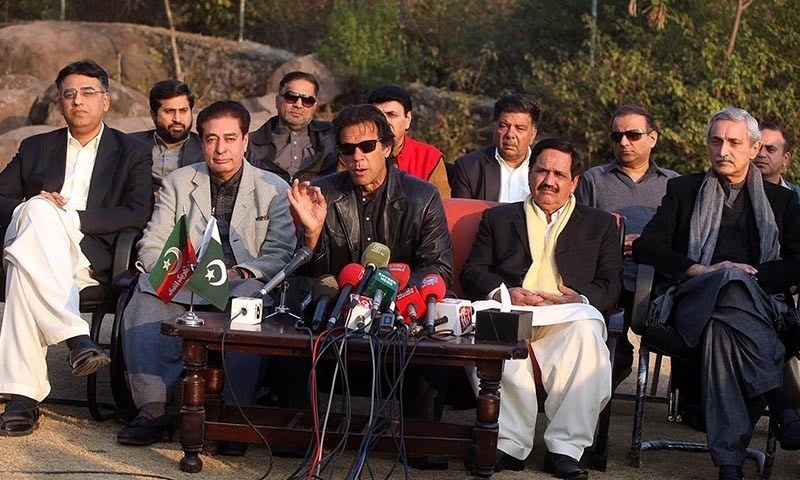 Pakistan Tehreek-i-Insaf (PTI) Chairman Imran Khan addressing a press conference at his residence along with PML-Q leaders Riaz Fatyana and Saeed Ahmed Virk who joined PTI.— INP