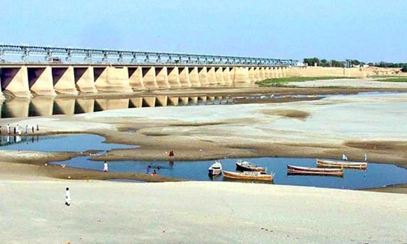 File photo shows fishermen's boats lie stranded in small pool of water in the River Indus at Hyderabad.— APP Photo