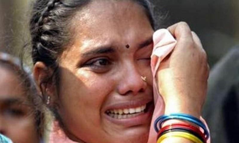 An Urdu speaker stranded Pakistani woman cries in Dhaka, Bangladesh as police arrest her brother.—Reuters/File