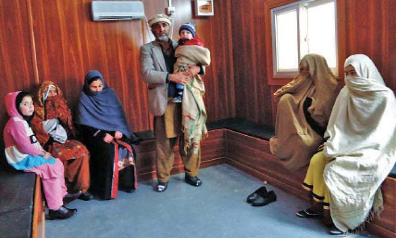 A family waits at a shelter room for the Lowari tunnel to open. — Online