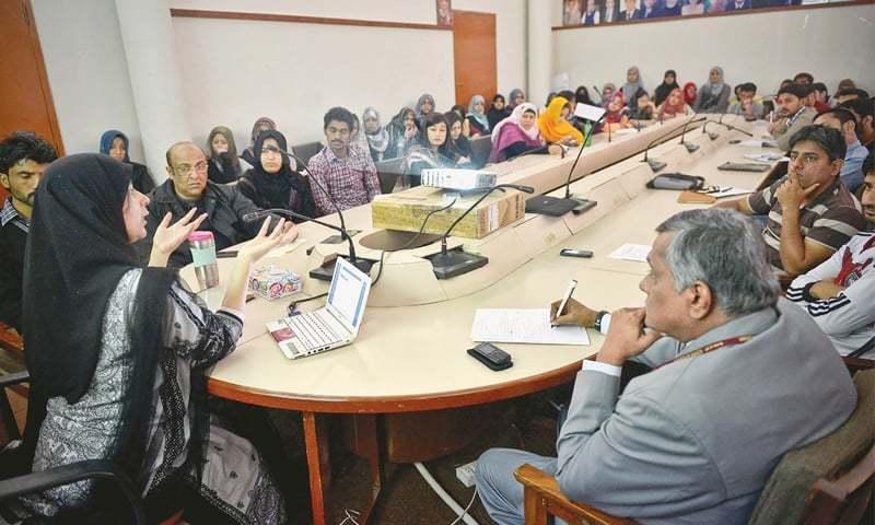 Sadia Tasleem gives a presentation at the department of international relations, University of Karachi, on Wednesday.—White Star