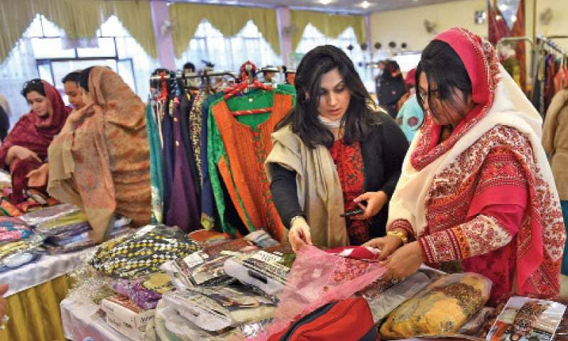 Visitors at a stall during a two-day trade fair organised by Trade Development Authority of Pakistan in collaboration with Women Chamber of Commerce and Industry (WCCI) in Peshawar on Wednesday. — Photo by Abdul Majeed Goraya