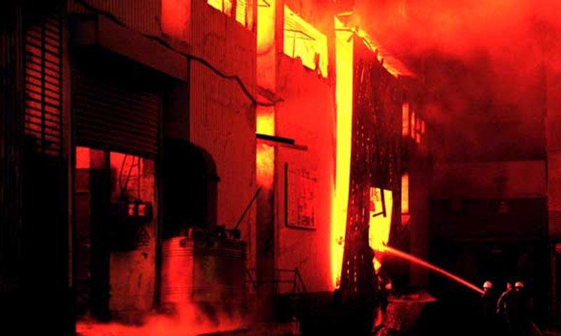 File photo shows fire-fighters trying to control the blaze at the garment factory in Baldia.—AFP/File