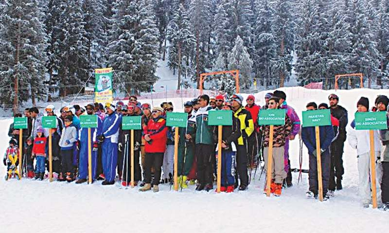 GILGIT: Ski teams pose with Air Force Commander Kalabagh Syed Abdullah and GB Secretary Tourism and Sports S.M. Hadi during the inaugural ceremony of the National Ski Championship at Naltar valley.