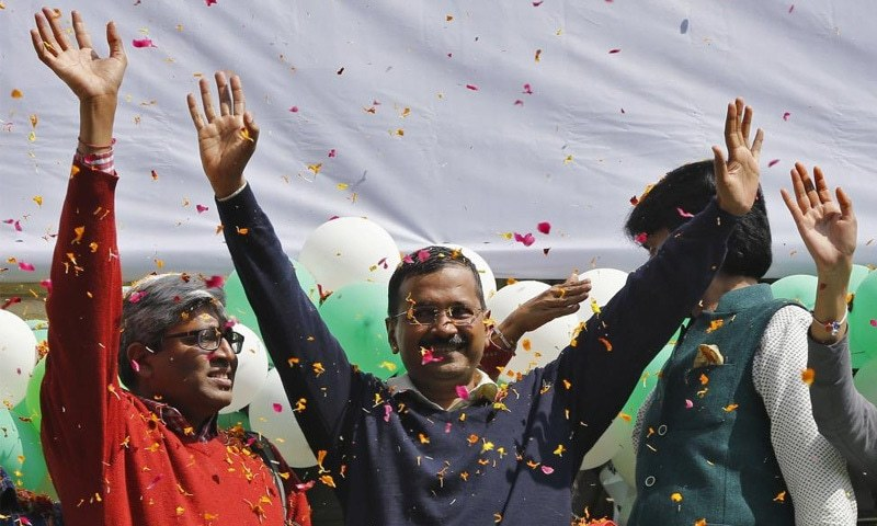 Aam Aadmi Party (AAP) chief and its chief ministerial candidate for Delhi, Arvind Kejriwal (C) waves to his supporters in New Delhi February 10, 2015. —Reuters