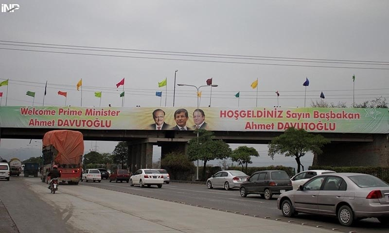 Welcome banners for Turkish Prime Minister Ahmet Davutoglu are seen hanging on a bridge at Expressway in Islamabad. —INP