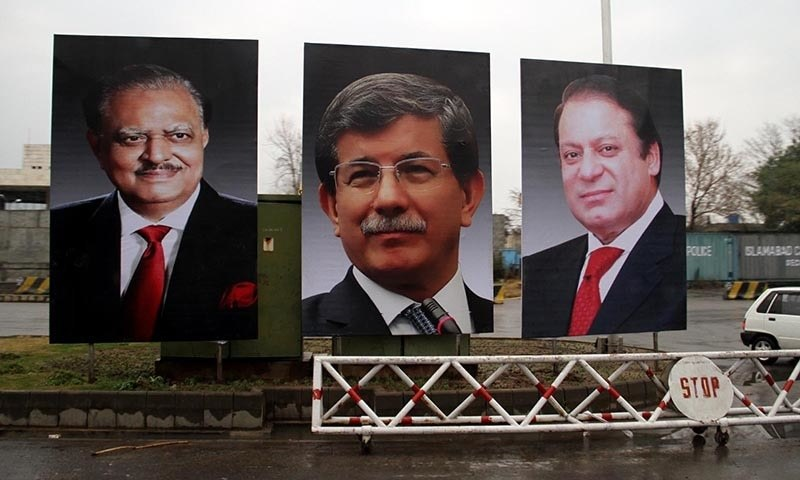 A portrait of Turkish Prime Minister Ahmet Davutoglu is seen at the Constitution Avenue in Islamabad.  —INP