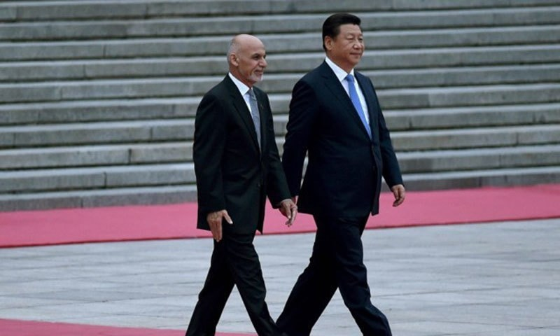 This file photo shows Afghanistan's President Ashraf Ghani (L) and Chinese President Xi Jinping (R). — AFP
