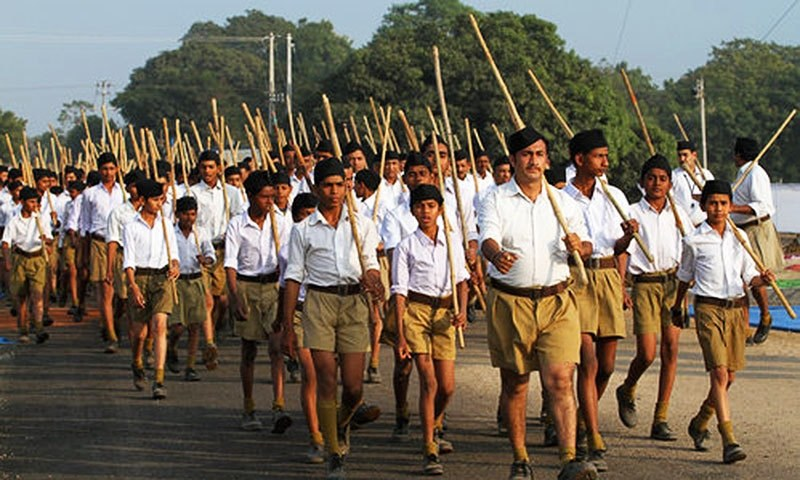 Volunteers of the Rashtriya Swayamsevak Sangh (RSS) march through a street during a three-day workers camp on the outskirts of Ahmadabad. —AP/file