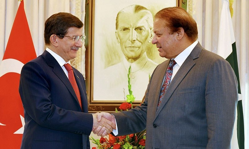 This handout photograph released by the Press Information Department (PID) shows Prime Minister Nawaz Sharif shaking hands with his Turkish counterpart, Ahmet Davutoglu in Islamabad. -AFP Photo
