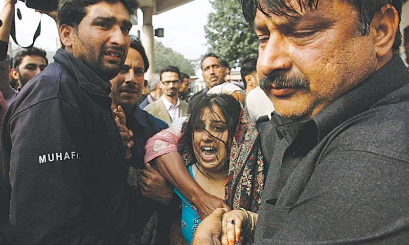 LAHORE: A woman mourns the death of her relative in a bomb blast near the police headquarters here on Tuesday.—Reuters