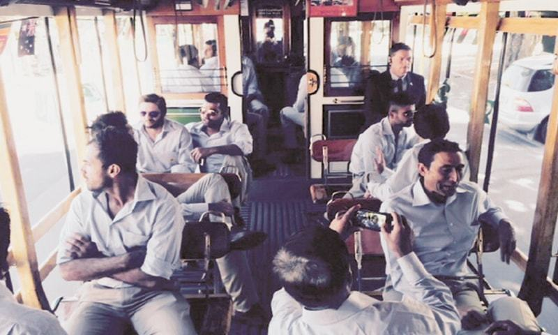 CHRISTCHURCH: Members of Pakistan squad travel on a tram for a reception by the Pakistani community here on Wednesday.—Courtesy PCB