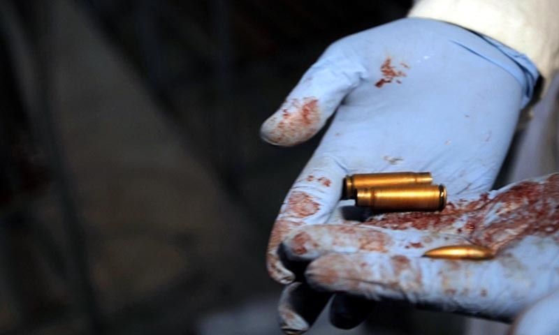 Forensic expert shows the bullet shells fired by TTP during their attack on Army Public School. — INP/File