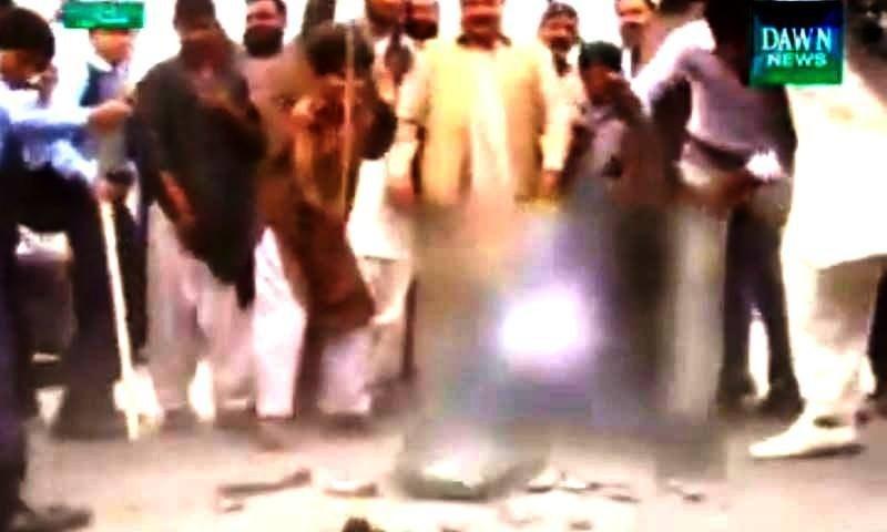 Fans vent their frustration by smashing an old TV set in Multan — DawnNews screengrab