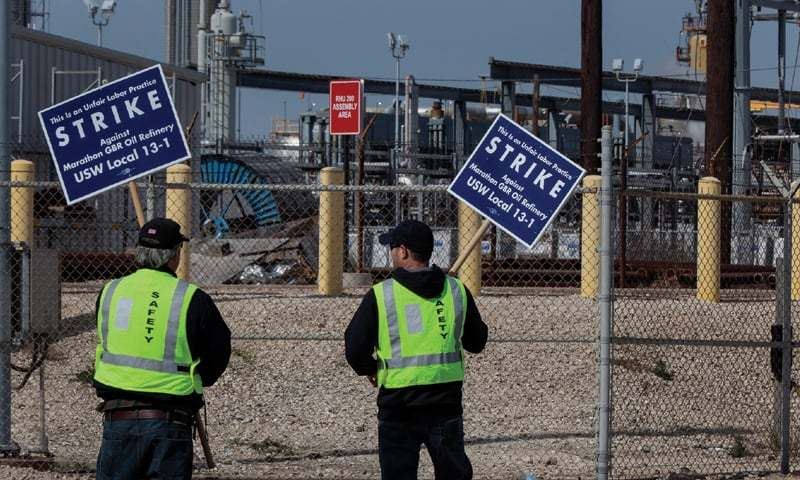 TEXAS CITY: Union workers holding placards in front of Marathon Petroleum's Galveston Bay refinery in this file photo.—Bloomberg