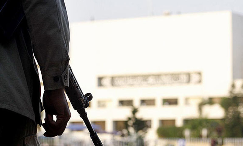A security official and his gun is seen in the image.—Online/File