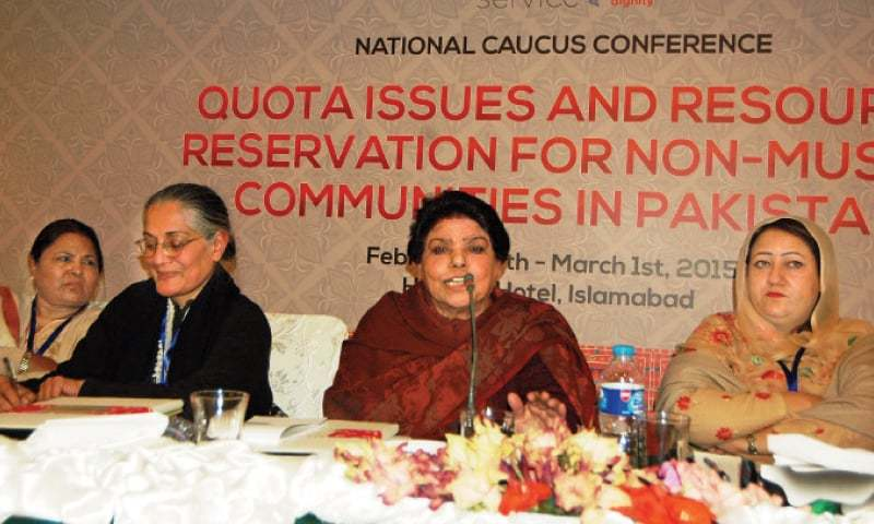 Kishwar Naheed speaks at the conference on Friday. Activist Tahira Abdullah is also seen. — White Star