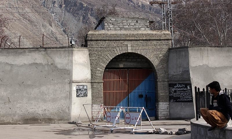 A resident sits outside the district jail in Pakistan's northern area of Gilgit on February 27, 2015, from which a key terror suspect, Habib-ul-Rehman managed to escape. — AFP