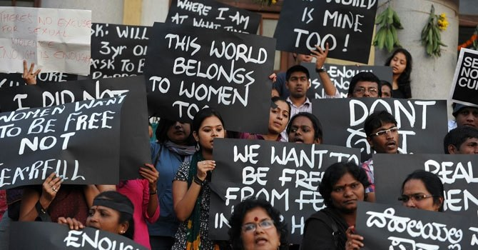 Indian activists belonging to various rights organisations hold placards while they stage a demonstration in Bangalore on Dec 21, 2012, condemning the recent gang rape in New Delhi. — Photo by AFP