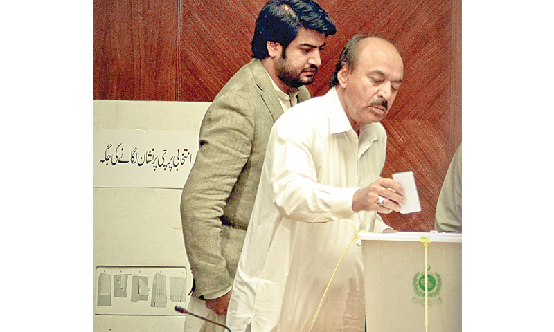 Senior Minister Nisar Khuhro casts his vote in Committee Room No I of the Sindh Assembly building on Thursday.—Fahim Siddiqi / White Star