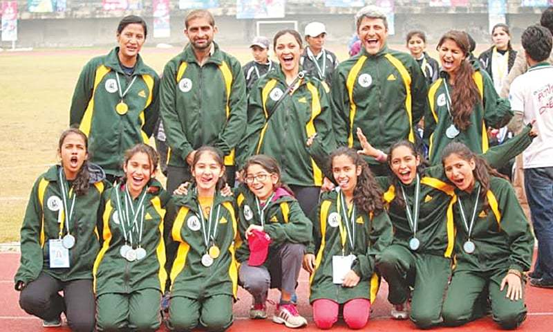 LAHORE: Members of Sindh women's athletics squad pose for a group photo after winning the runners-up trophy here on Saturday.