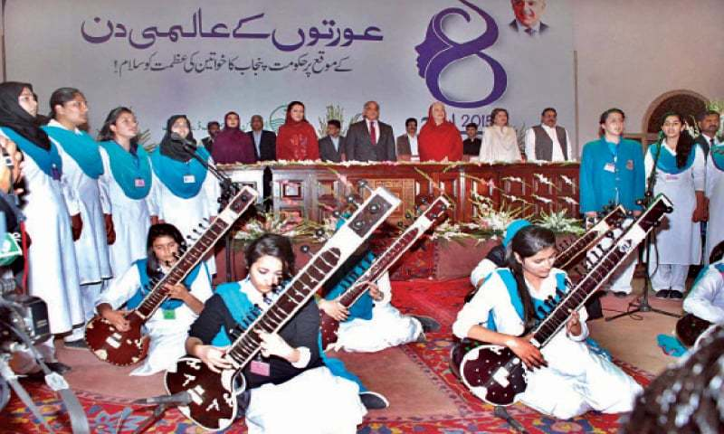 Chief Minister Shahbaz Sharif and others join students in singing national anthem at a seminar on the International Women's Day at Aiwan-i-Iqbal.—APP
