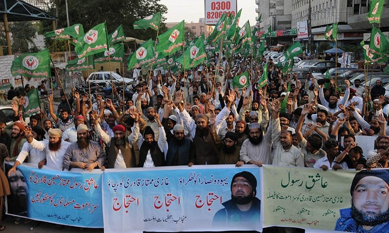 Supporters of Mumtaz Qadri rally to protest against a court decision in Karachi, Pakistan, Monday, March 9, 2015. — AP