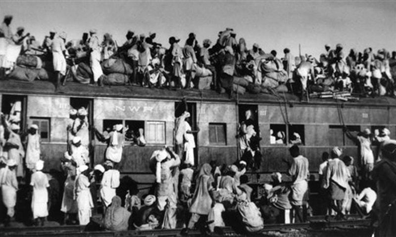 Sept. 19, 1947: Muslim refugees sit on the roof of an overcrowded coach railway train near New Delhi in trying to flee India. Millions of Muslims migrated from India to Pakistan. Partition marked a massive upheaval across the subcontinent. Hindus living for generations in what was to become Pakistan had to flee their homes overnight. —AP/file