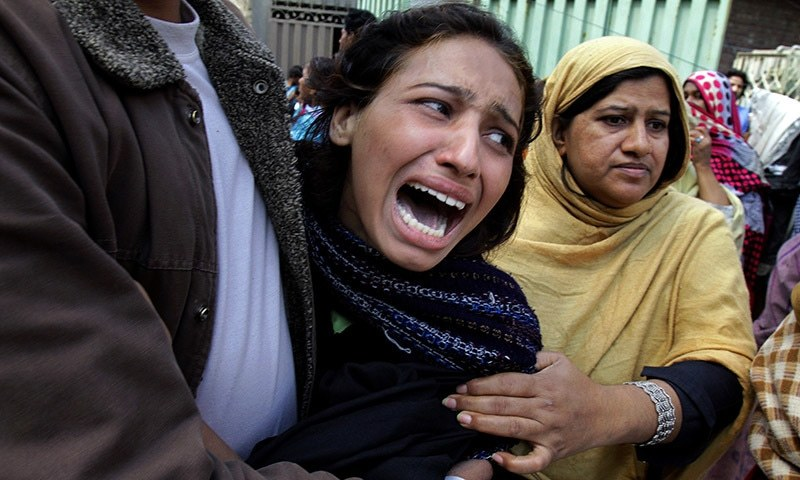A woman mourns the death of a family member who was killed from a suicide bombing attack near two churches in Lahore, Pakistan, Sunday, March 15, 2015. — AP
