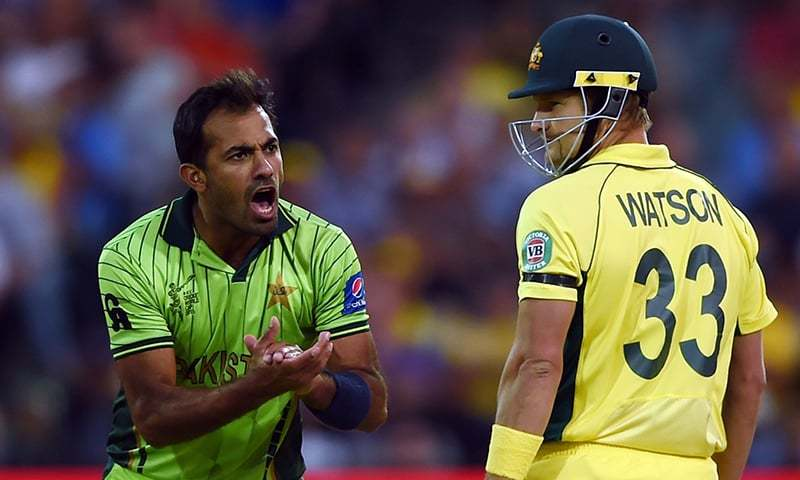 Pakistani cricketer Wahab Riaz (L) reacts after bowling to Australian batsman Shane Watson during the 2015 Cricket World Cup quarter-final match between Australia and Pakistan in Adelaide on March 20, 2015 ─  AFP