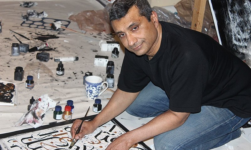 Adil Akhtar prefers to paint, sitting on the floor. —Photo by author