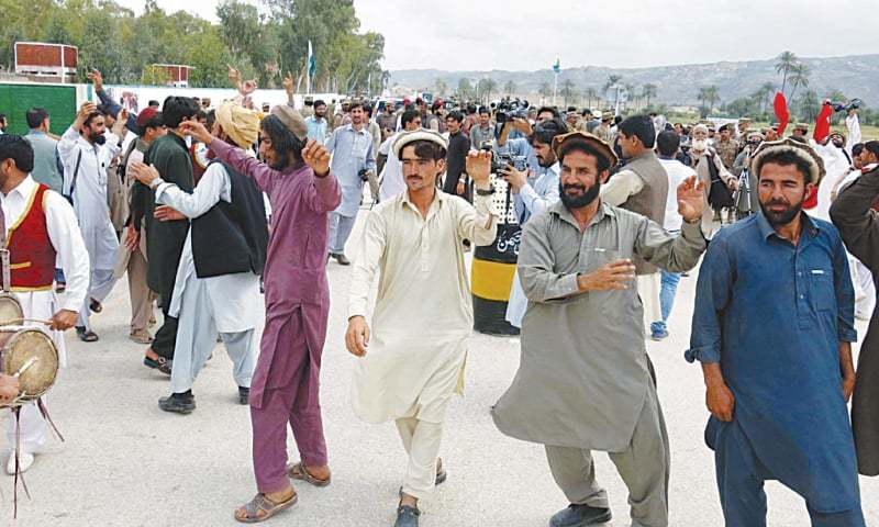 BANNU: Internally displaced people dance at the Kajuri Checkpost to celebrate their return to their homes here on Tuesday.—INP