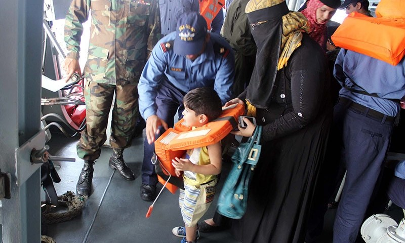 A child along with his mother onboard Pakistan Navy Ship  ASLAT after evacuation operation in Al-Mukalla on Saturday, April 04, 2015. — PPI