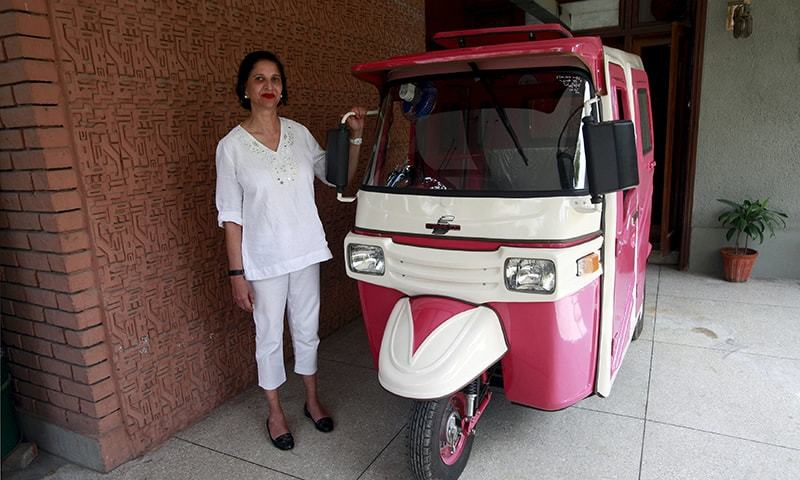 Zar Aslam, president of Pakistan's non-profit Environment Protection Fund, poses beside a Pink Rickshaw in Lahore April 8, 2015. — Reuters