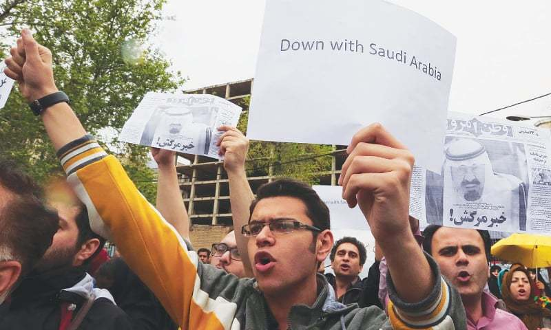 Tehran: Iranians hold a demonstration outside the Saudi embassy on Saturday to protest alleged harassment of Iranian youths by Saudi police.—AFP