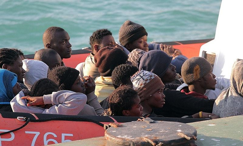 Migrants on a Coast Guard dinghy boat arrive at the Sicilian Porto Empedocle harbor, Italy, Monday, April 13, 2015.— AP