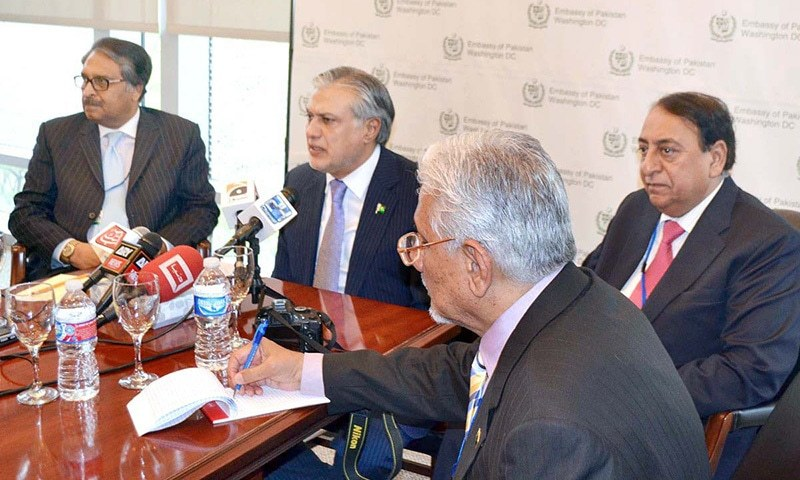 Finance Minister Ishaq Dar  addressing a press conference in Washington. — APP/file