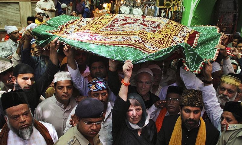 "People carry a holy ""Chaddar"" (shawl) to offer it at the shrine of Muslim Sufi saint Khwaja Moinuddin Chishti during a Urs procession at Ajmer in the desert Indian state of Rajasthan April 20, 2015. — Reuters"