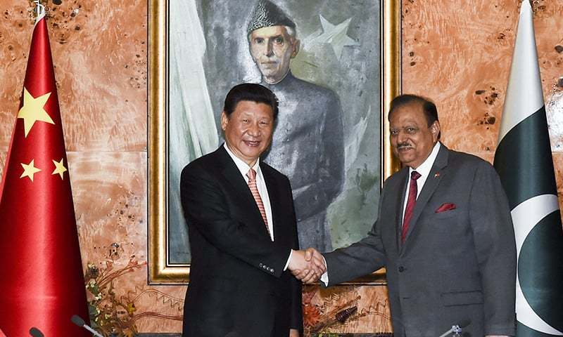 Chinese President Xi Jinping shakes hands with his Pakistani counterpart Mamnoon Hussain in Islamabad. — AP