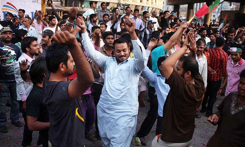 MQM supporters dance to celebrate victory of their candidate for NA-246 Kunwar Naveed Jamil. -Online