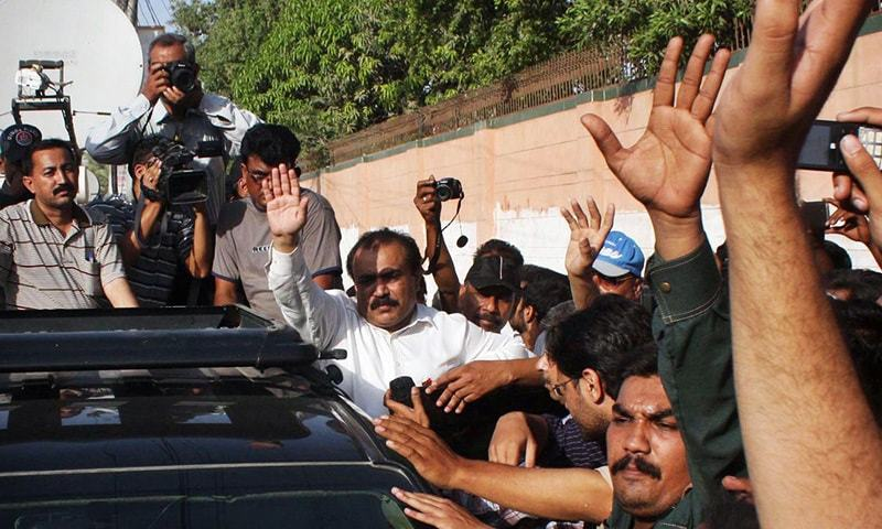 MQM candidate for NA-246 Kunwar Naveed Jameel waves to supporters slogans during his visit to a polling station in Azizabad on the eve of by-election in NA-246.— Online