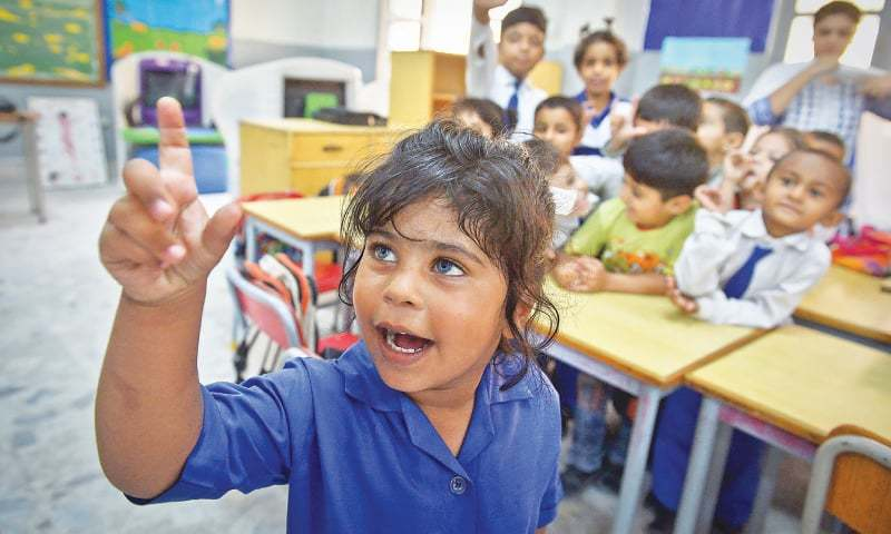 VANYA, a student of the Deaf Reach school in Karachi's Gulistan-i-Jauhar area, signs an answer to a question posed by her teacher in the classroom.—Fahim Siddiqi / White Star
