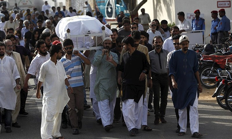 People carry the coffin of Sabeen Mahmud during her funeral in Karachi, Pakistan April 25, 2015.  — Reuters