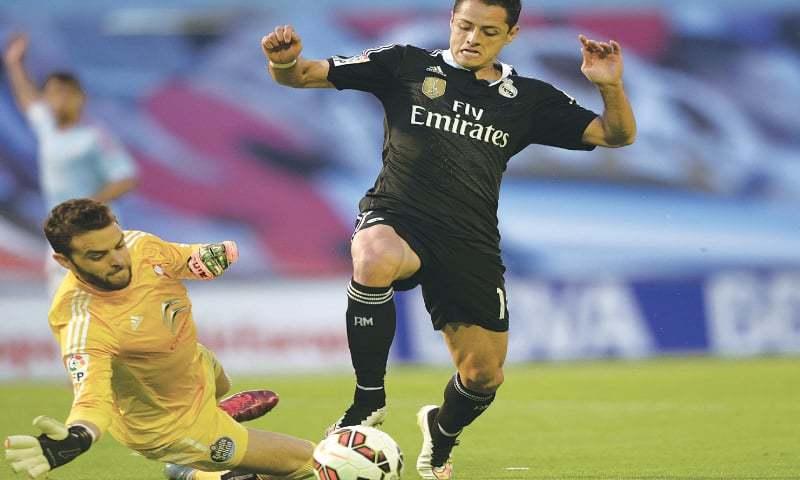 334afcb4f Real Madrid s Javier Hernandez vies with Celta Vigo goalkeeper Sergio  Alvarez during their La Liga match